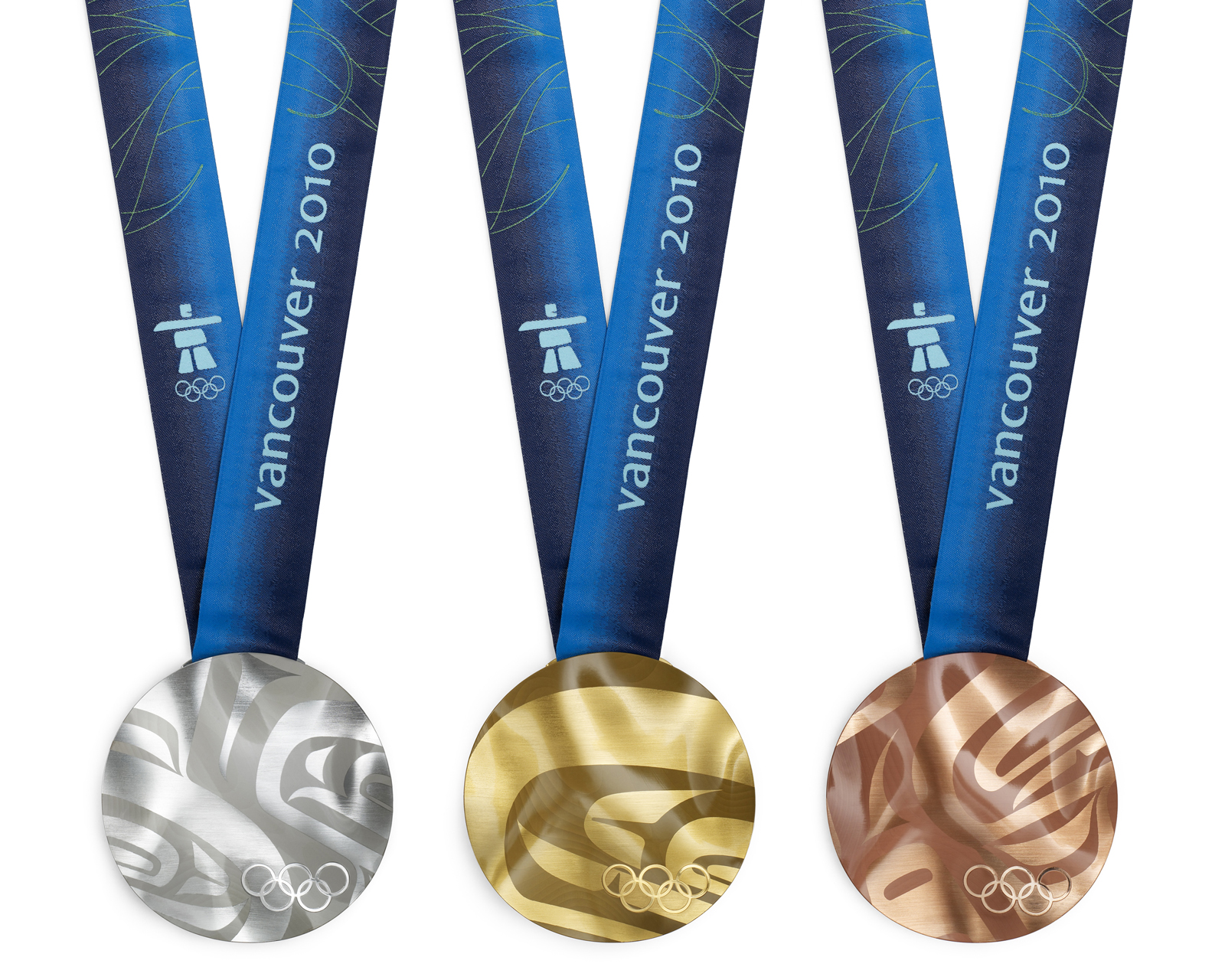 Arbel: Due to manufacturing constraints, conservatism, and budget concerns, the design was addressed and re-purposed several times.The final production version has an undulating surface that evokes Vancouver's landscape. Individual medals were laser etc