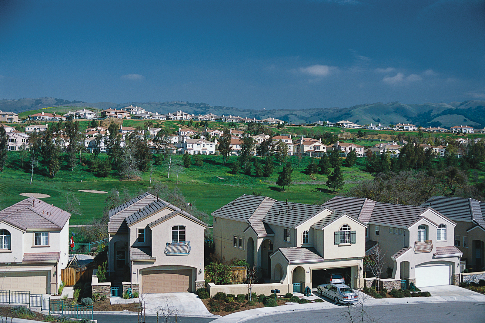 Home developments built around golf courses are often designed as insular sites that disregard the opportunities for social interaction presented by community oriented landscape architecture.