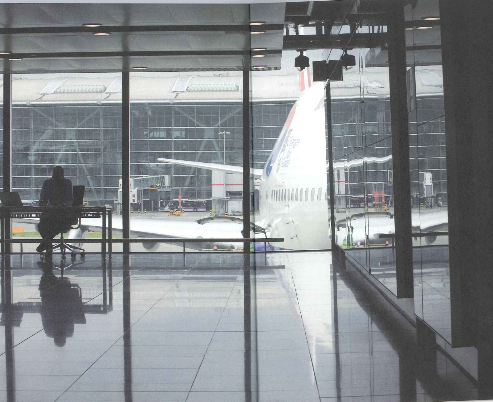 Here's a photo from Terminal 5 out toward one of the waiting jets. The photo is by Richard Baker, who took a number of seemingly pedestrian photos for the book that actually reveal much of the poetry of the terminal.