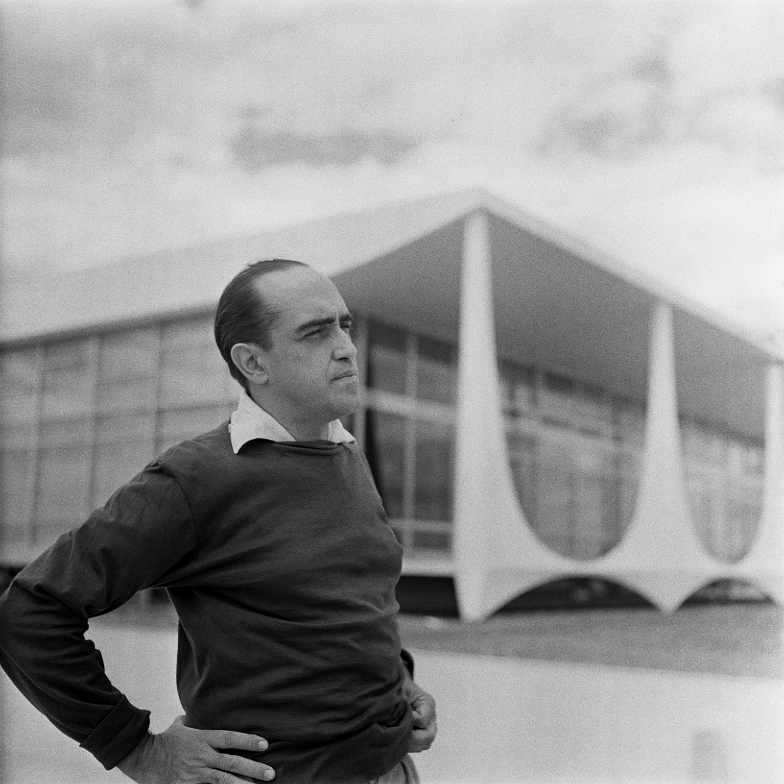 Oscar Niemeyer, one of the architects behind Brasilia's grand modernist vision, stands in front of the Supreme Court. Photo by Gil Pinhero.
