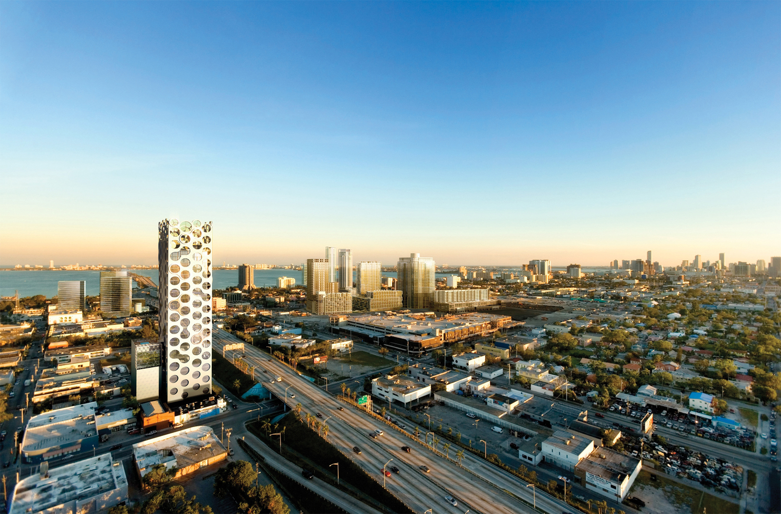 The COR condo tower in Miami features a score of circular wind turbines.