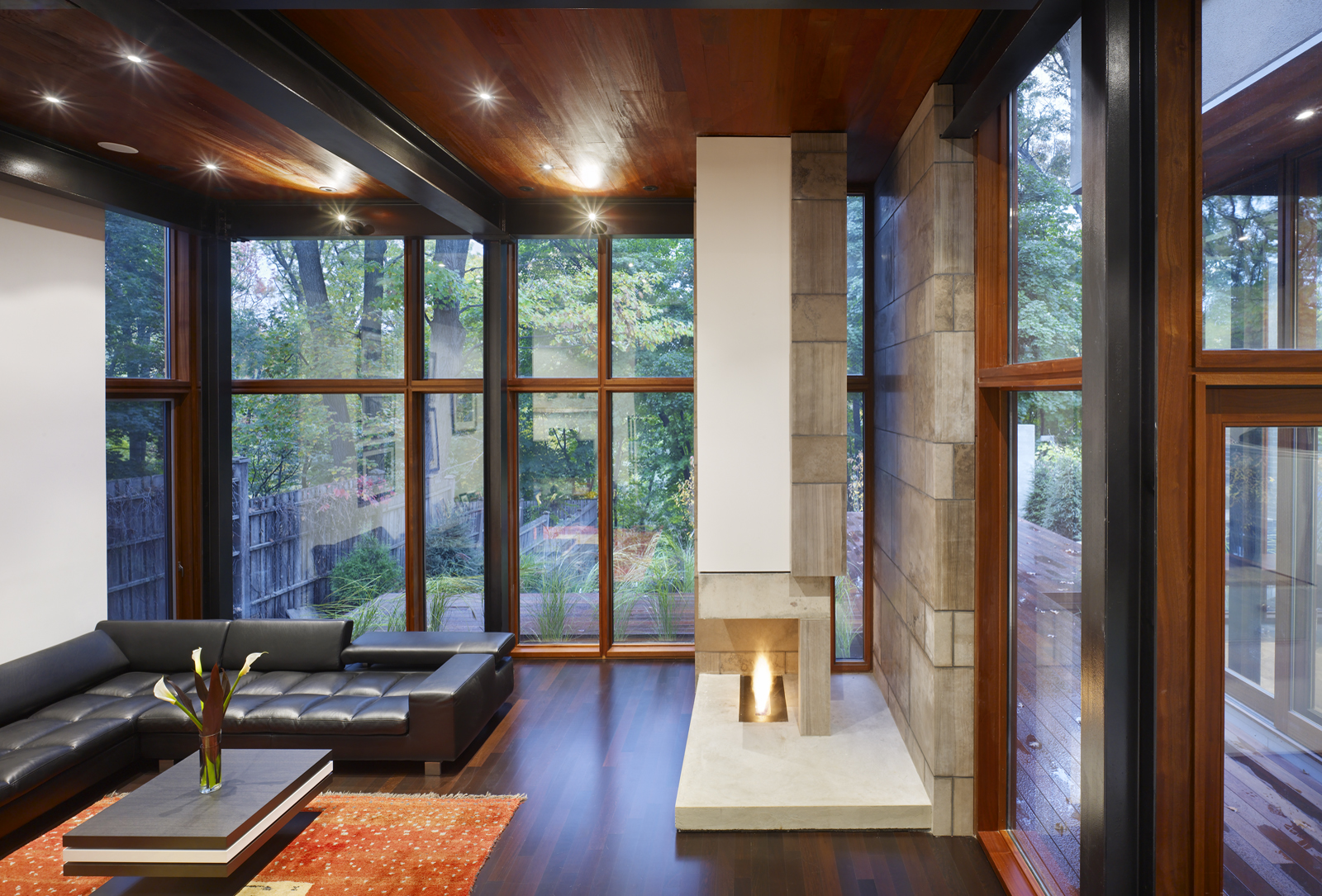 This shot of the Ravine House's interior shows its glazed back facade and clear geometry.