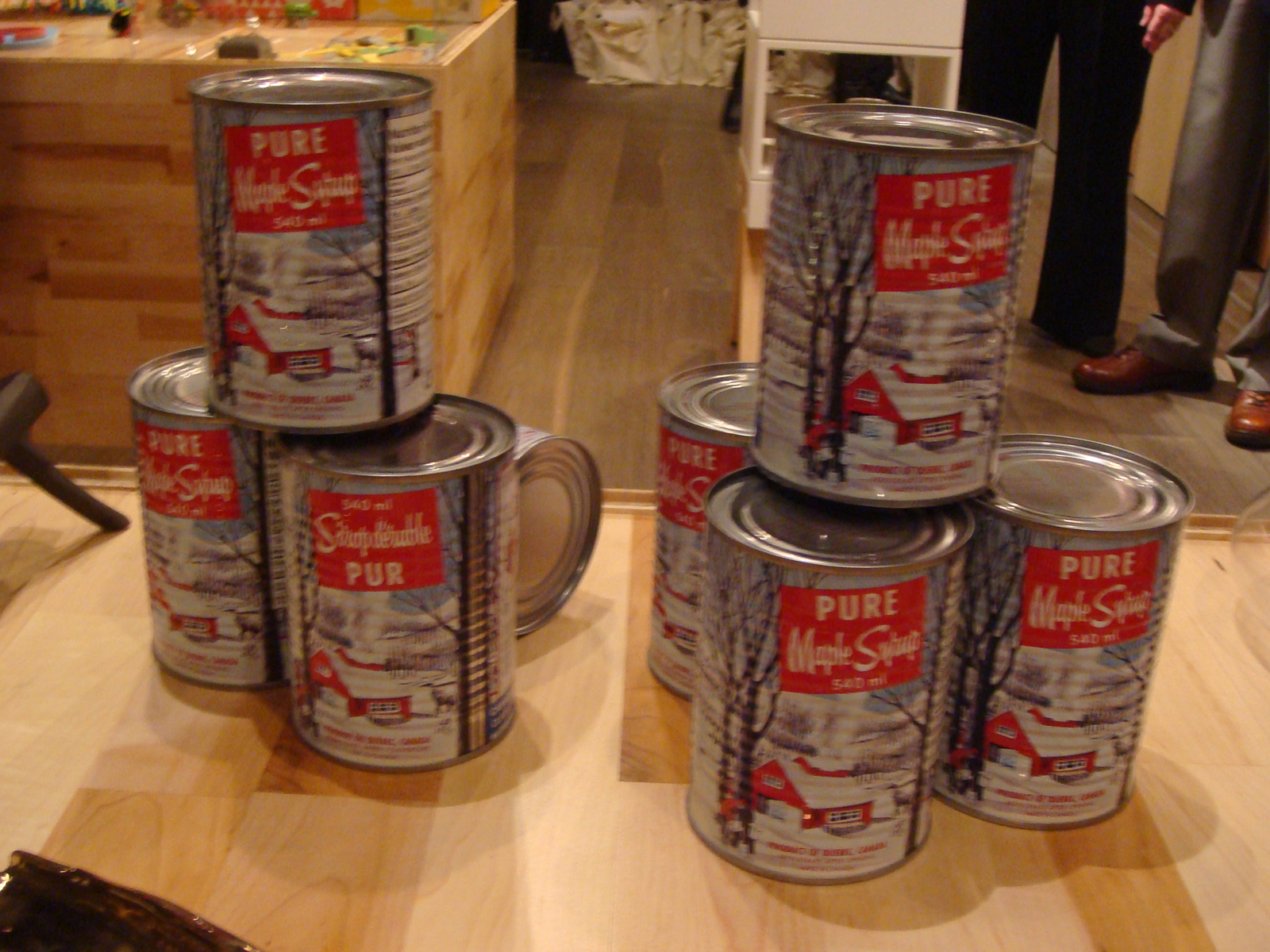 """One of the few references to maple in the show is <a href=""""http://www.bulkmaplesyrup.com/eng/home.html"""">Export 2002</a>'s pure maple syrup, held in a vintage-inspired can."""