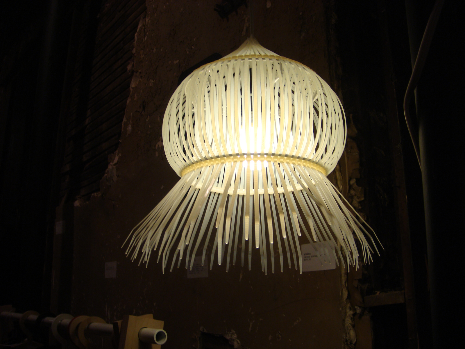 """Reflecting an innovative use of materials, <a href=""""http://www.bipede.ca.com"""">Bipede</a>'s jellyfish-esque suspension lamp is made from plastic zip ties."""