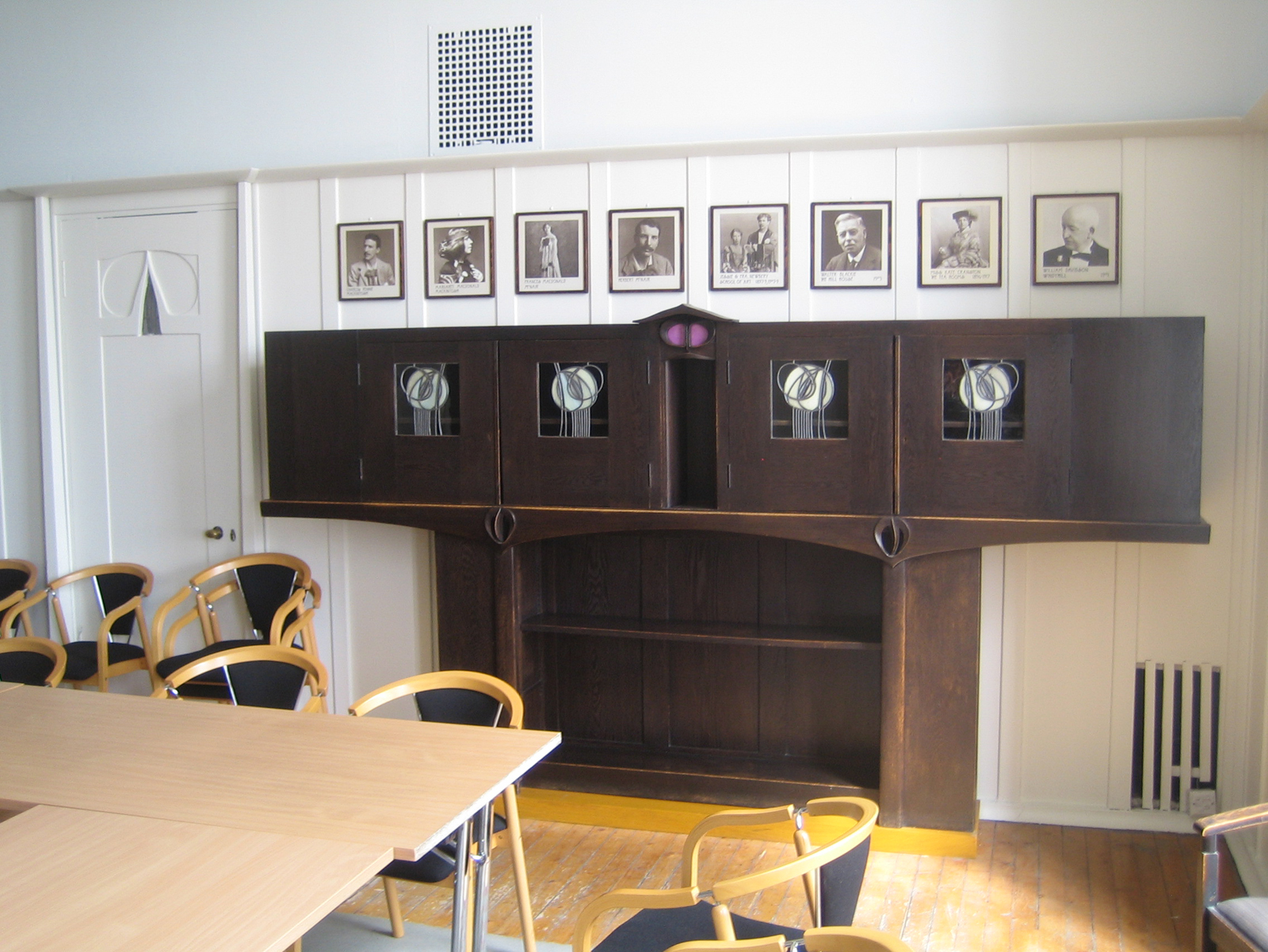 This hutch is simply too beautiful. The row of photos above charts famous alumnus and administrators at the Glasgow School of Art. Mackintosh (who attended as an architecture student) leads the pack.