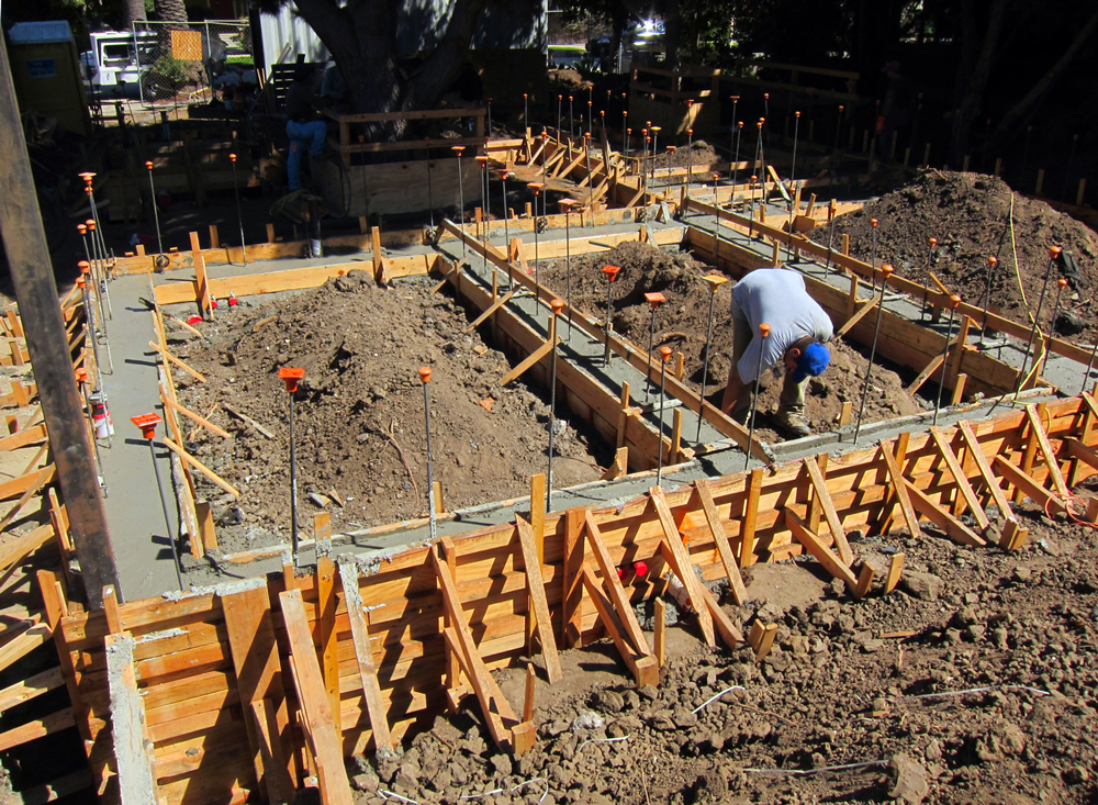 The footings start to cure. Next step is preparation for the slab pour.
