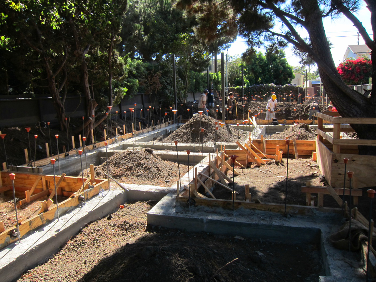 The concrete footings have cured and now preparations will begin for the concrete slab pour.
