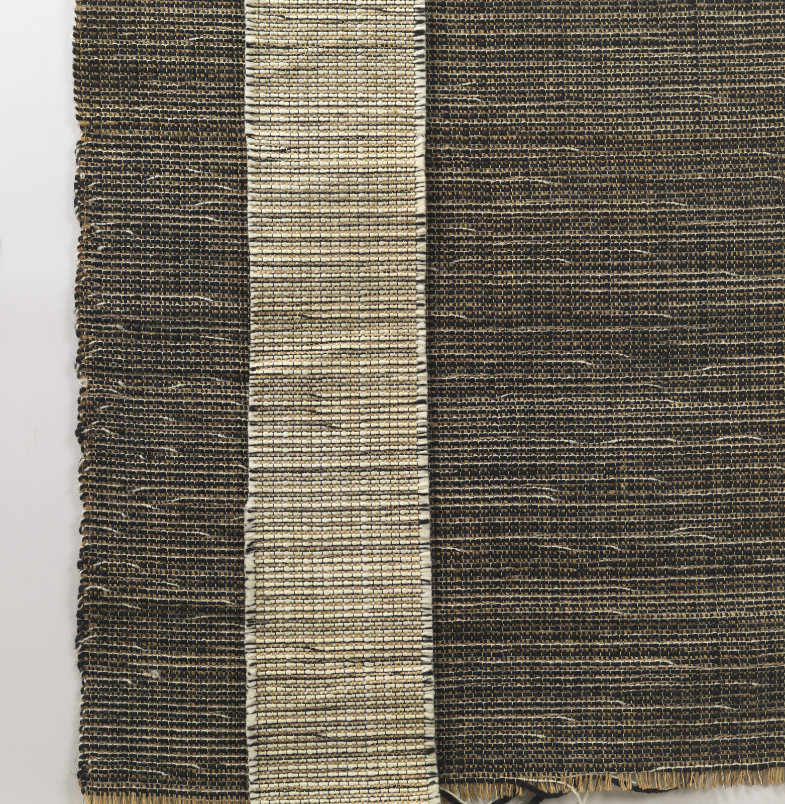 "In the early 1950s, Knoll hired Evelyn Hill Anselevicius to create a series of handwoven textiles, including this fabric titled H910. ""What's interesting about this one is that it's made of wool, plastic, and jute,"" Makovsky says. ""She was innovative, doi"