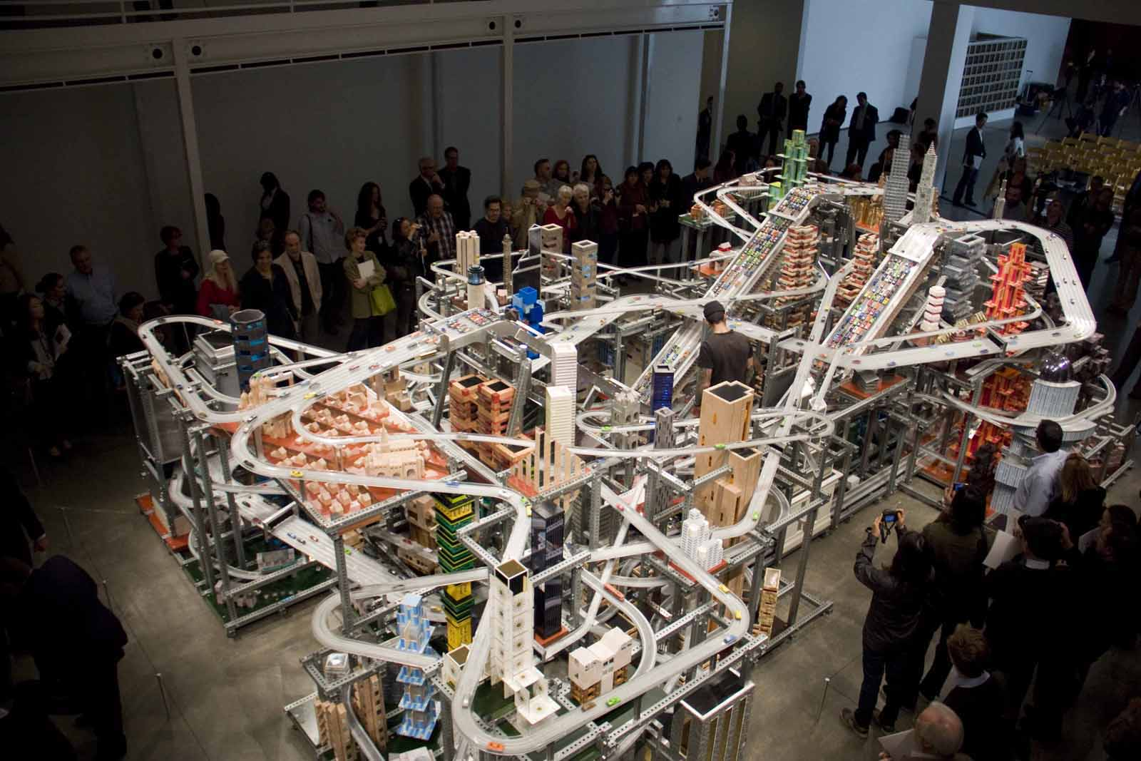 Metropolis II is a large-scale kinetic sculpture inspired by a Los Angeles of the future, with traffic moving at frenetic speeds.
