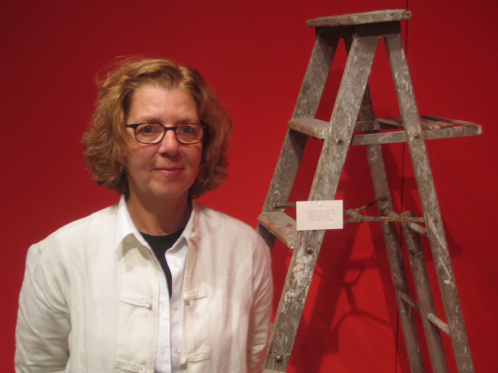 I snapped this photo of Maira in the gallery next to one of her ladders. The woman adores ladders.