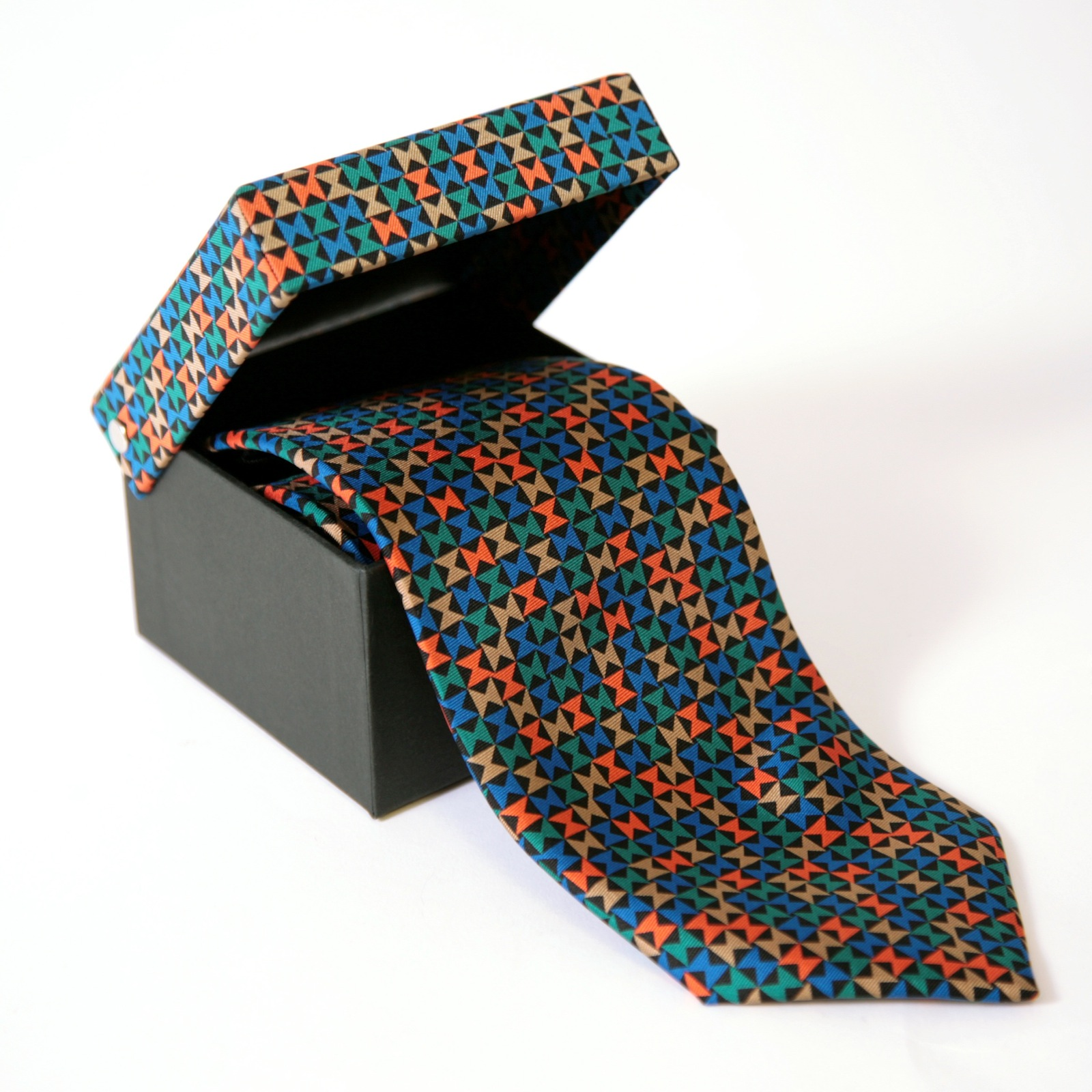 The Pinwheel pattern reappears in a different form on this graphic silk tie.