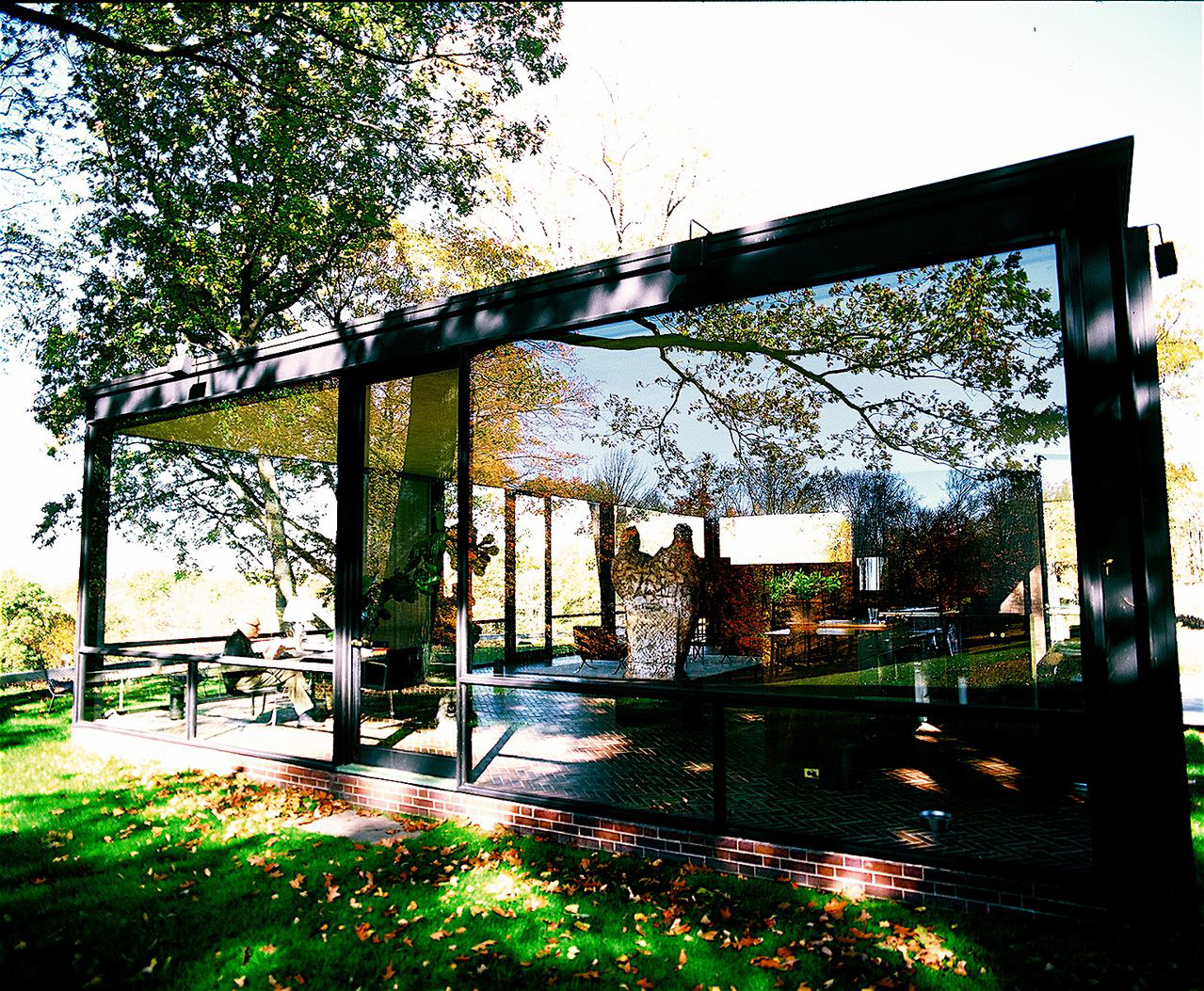 Philip Johnson in his Glass House. Philip was the first recipient of the Pritzker Prize award. I think it is the only photograph in which you see Philip in the house and the house in its entirety.