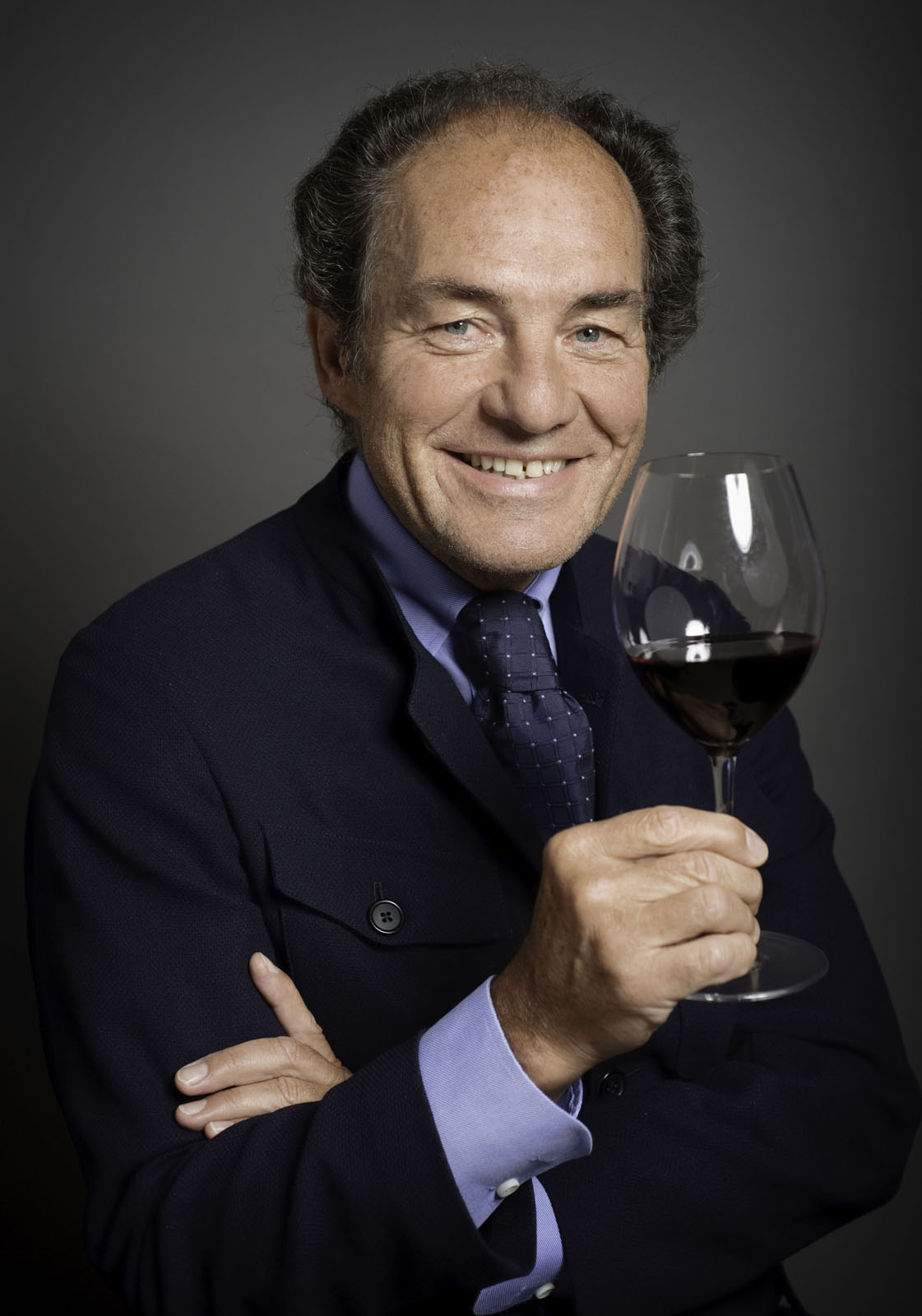 """Georg Riedel and a Riedel glass. I asked him if he travels with one of his wine glasses and he said that he does bring along a small one, """"an SOS version"""" of the Riedel stuff."""