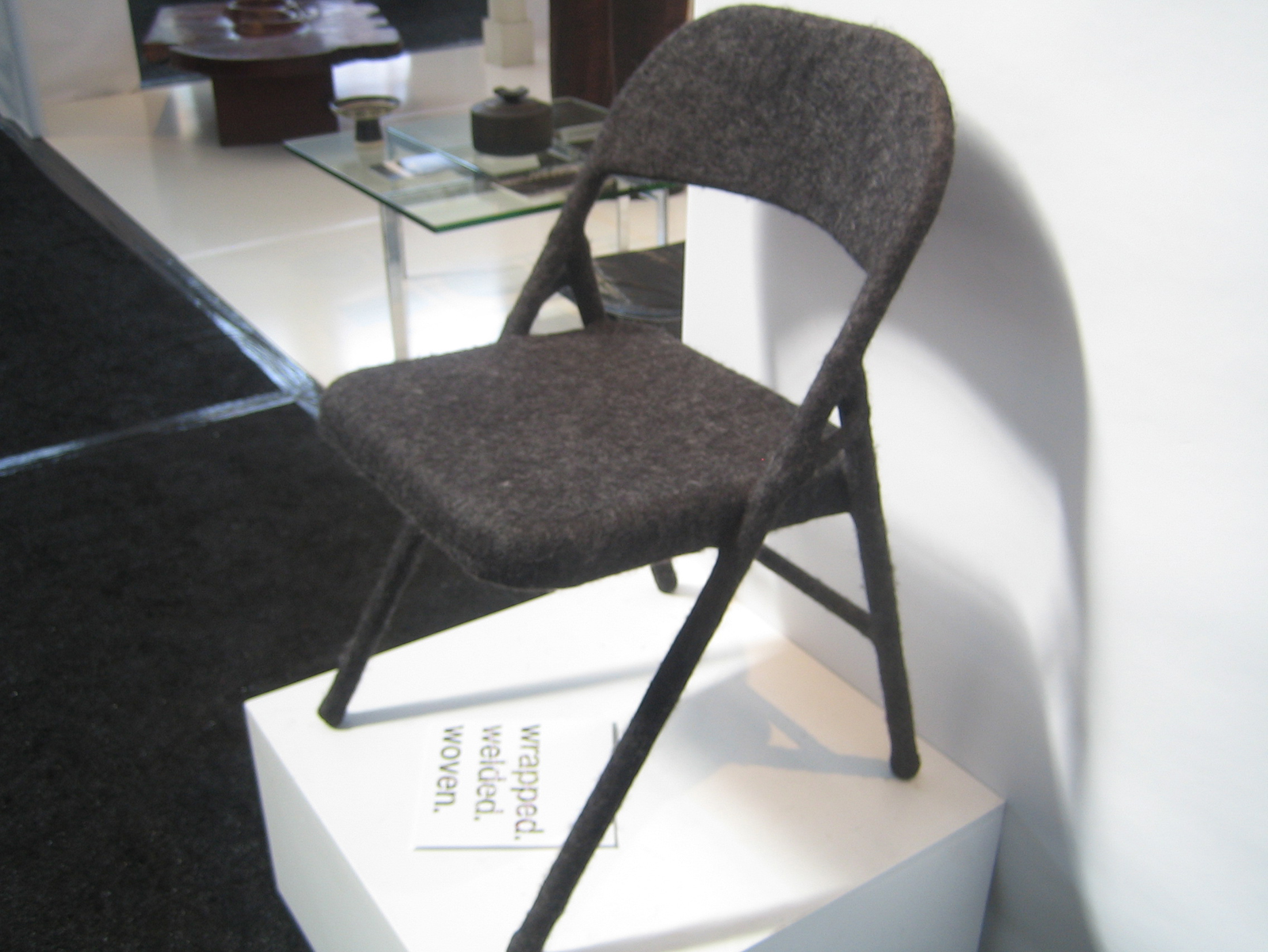 It may be hard to tell from the photo, but this standard metal folding chair has been felted in charcoal wool. Artist Tanya Aguiniga creates incredible furniture by wrapping, welding and weaving iconic and generic pieces. -Sarah