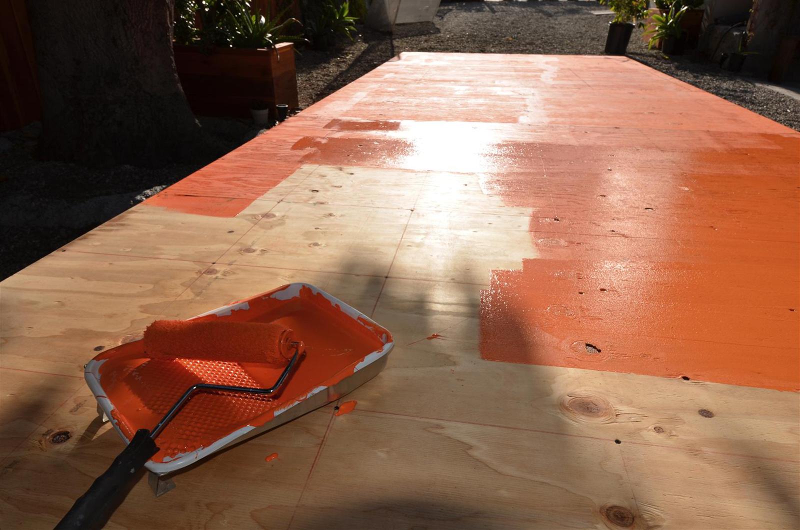 Painting the base coat bright orange.