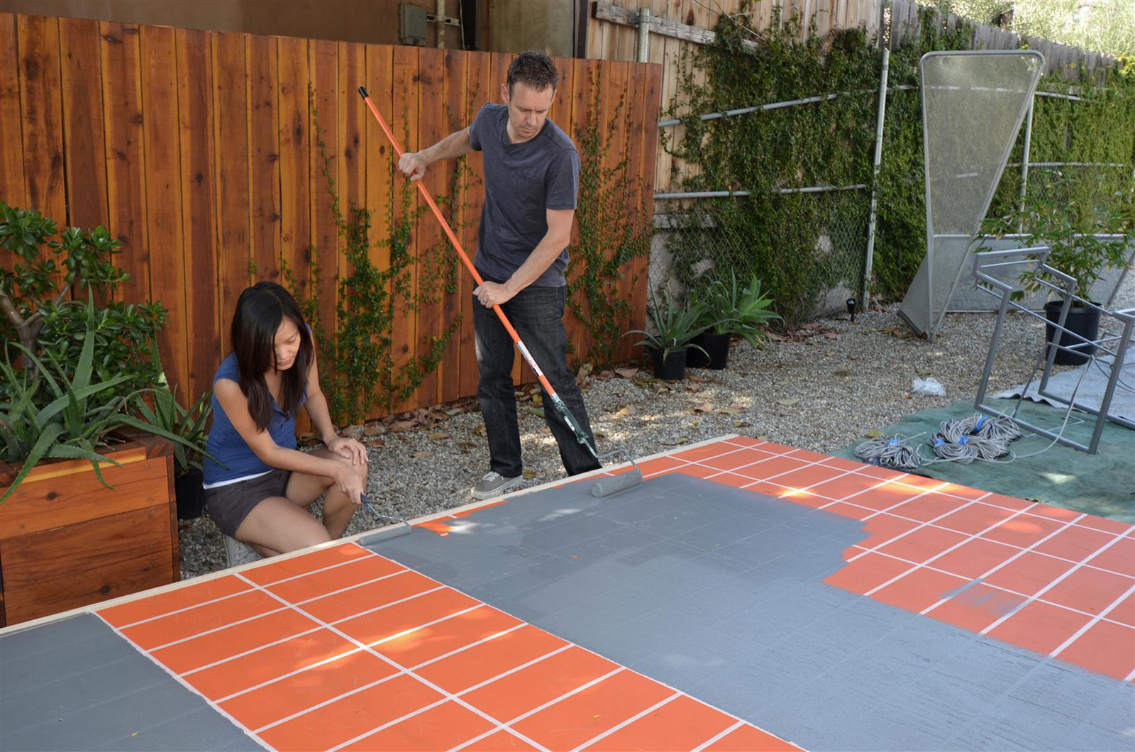 Taping the grid on the platform then painting the platform light grey.