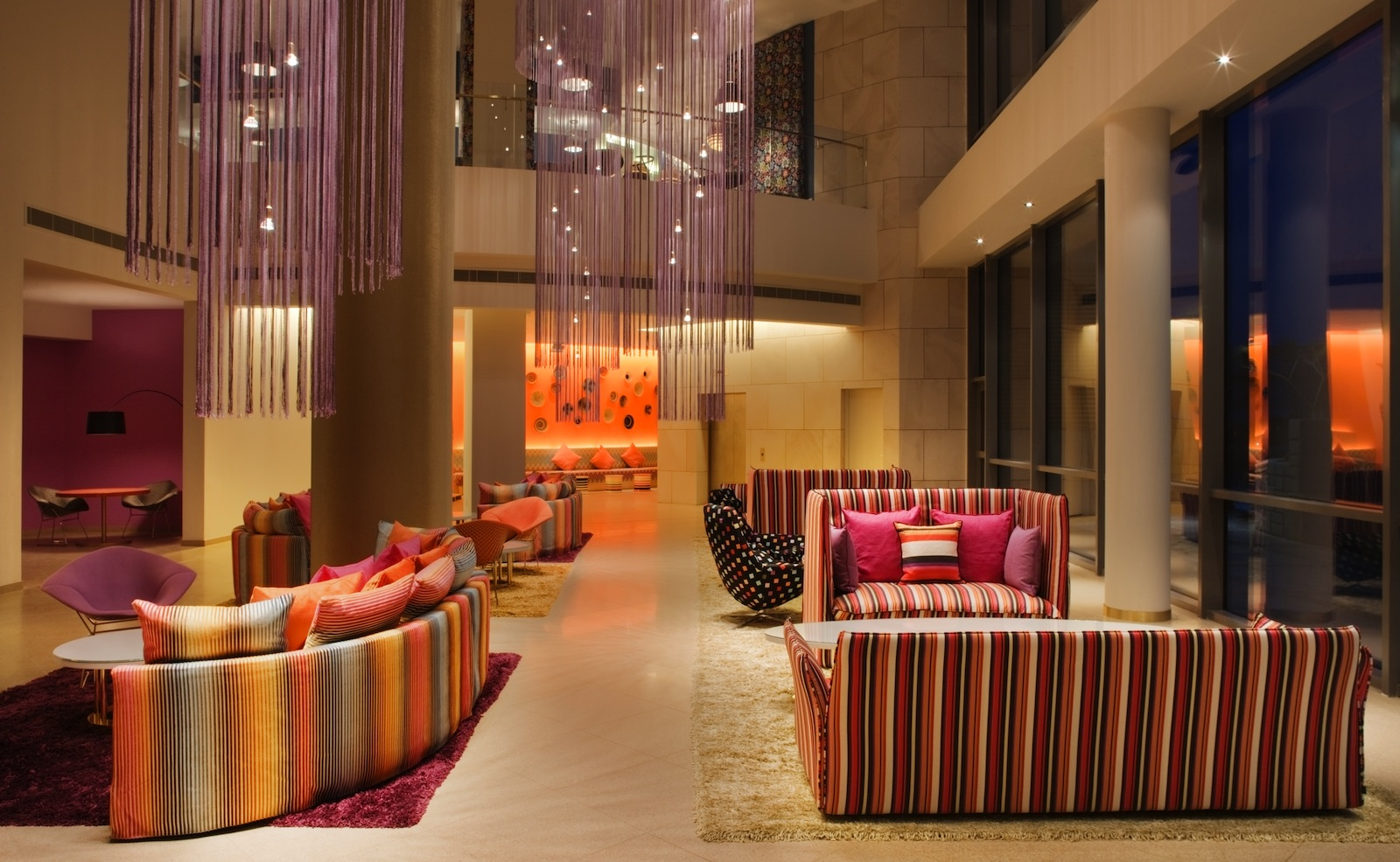 """The design and colors of the hotel are inspired by the destination—a graceful melding of Missoni and Kuwait's aesthetic. The Arabian Sea is reflected by the cool turquoise, bold fuschia, and gleaming golds in the hotel lobby. Photo by <a href=""""http://www."""