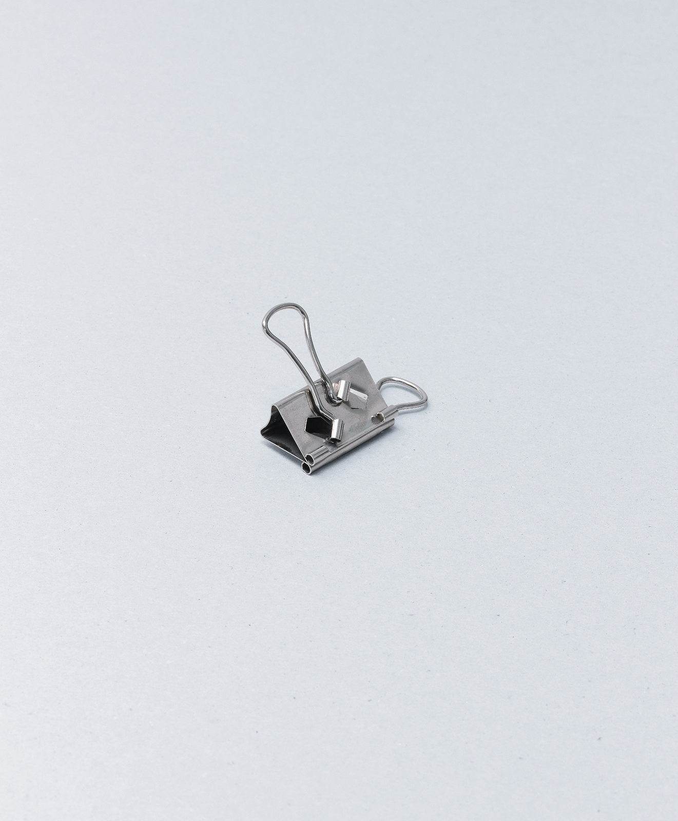"""""""A typical clip for holding papers together, but with an ingenious modification. The handles are folded at right angles to the clip so that it avoids obscuring text on the page.""""—Sam Hecht. Photo: © Usefulness in Small Things, Rizzoli, 2011."""