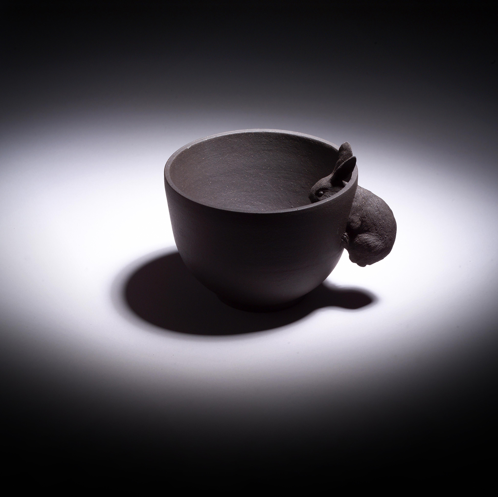 Moon Rabbit-Cup. Black clay. Designer: Hsiao-Ying Lin, Craft Maker: Jung-Ching Tang.