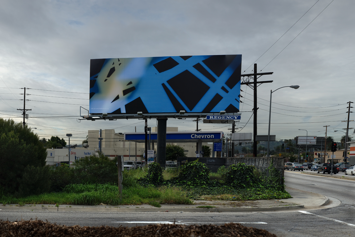Photographer James Welling's billboard, at La Brea Avenue south of the 10, suggests a fractured grid, canted city streets, and a fraying urban fabric. Photo by Patricia Parinejad.