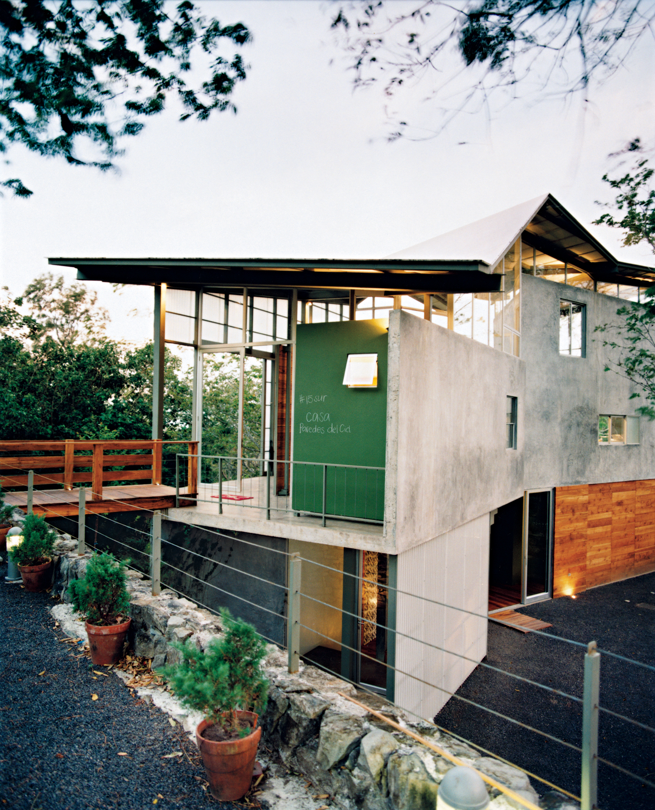 Banks of windows and translucent panels help keep Casa Tuscania nice and airy.