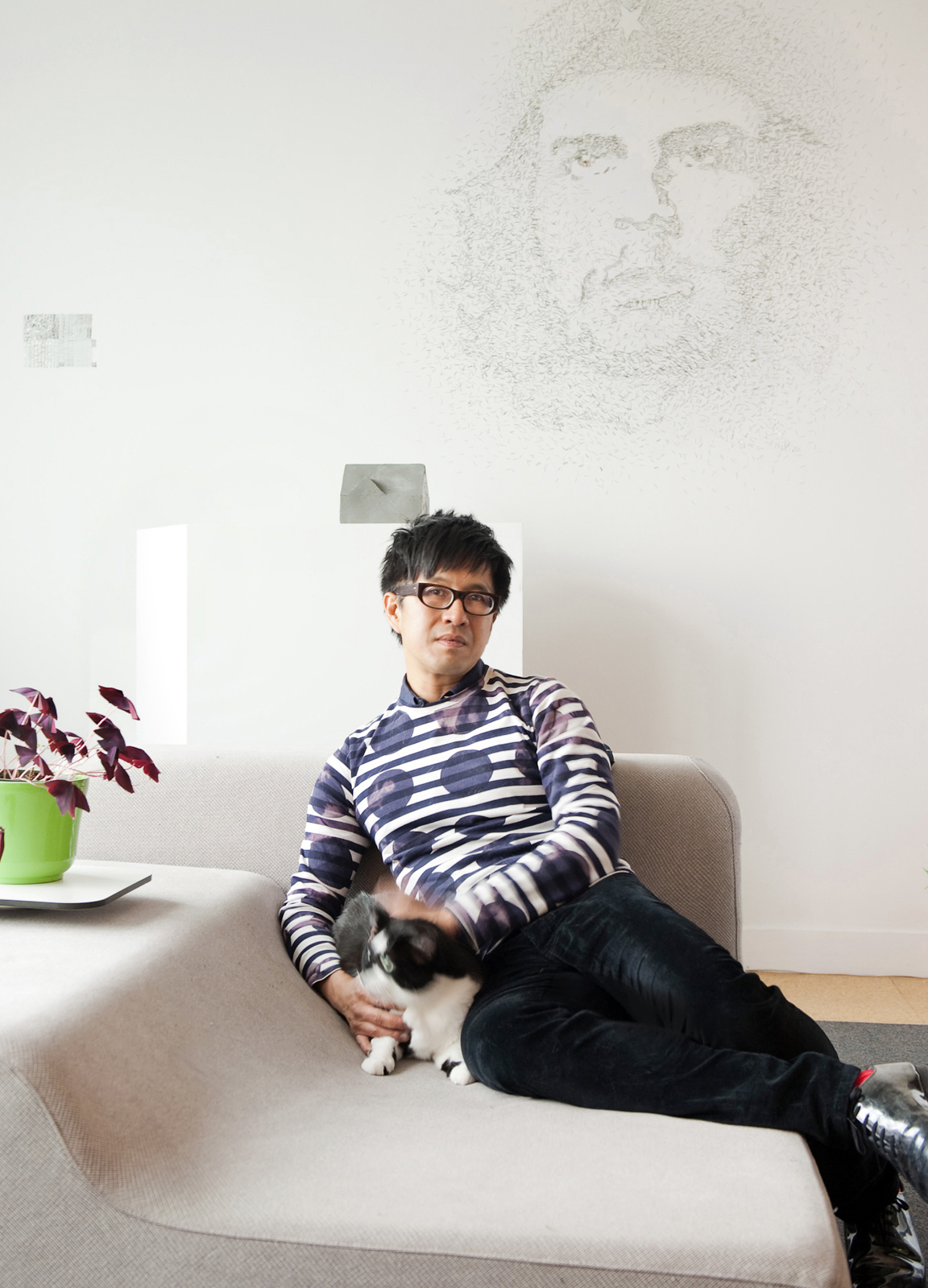 A wall sketch of Che Guevara is a focal point in architectural theorist and installation artist An Te Liu's living room.