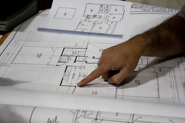 Architect and 'client' get into the nitty gritty. Photo by Sayamon Riddang, Bailey/Gardiner Creative.