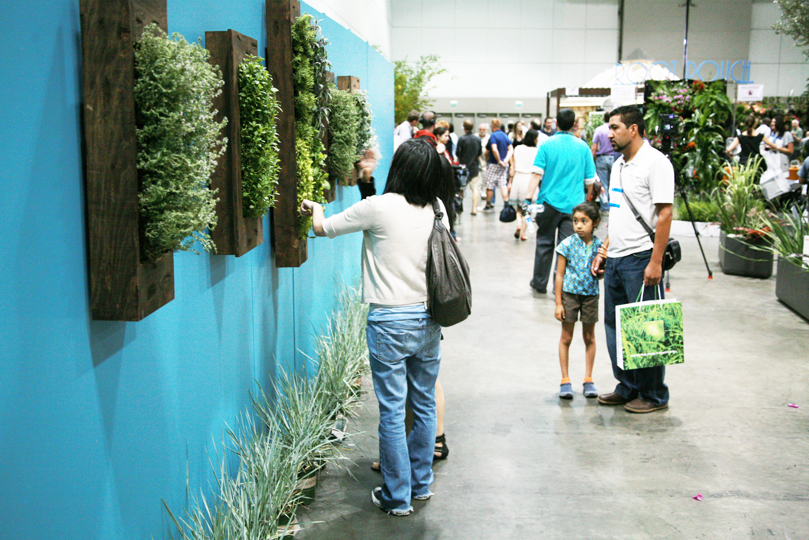 """A wall of hanging herb pockets by <a href=""""http://http://www.Theherbxchange.com/"""">The Herb Xchange</a>."""