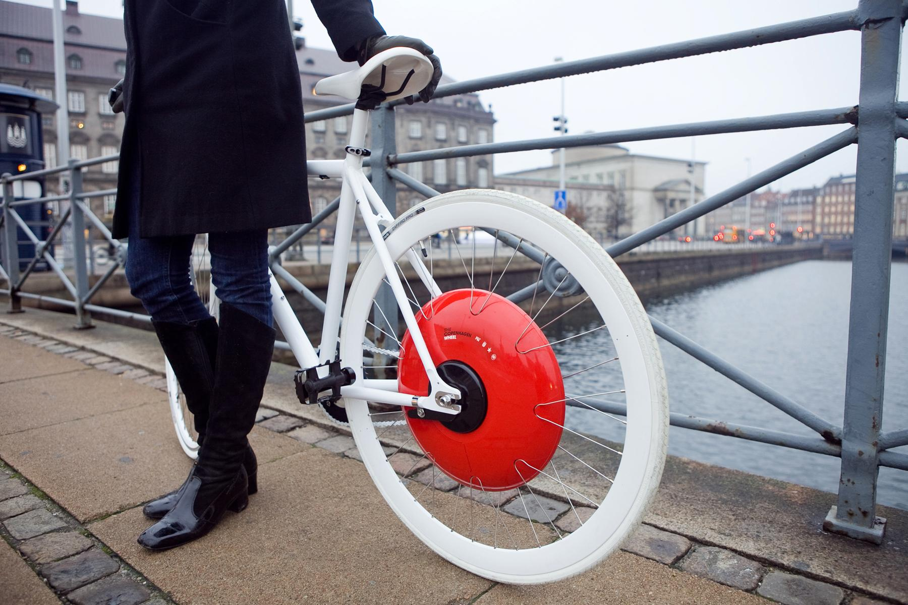 Here's the US National Winner: the Copenhagen Wheel. Christine Outram and a team of MIT students invented of a wheel that turns a regular bike into a smart, electric hybrid. The Copenhagen Wheel allows riders to capture the energy dissipated when breaking