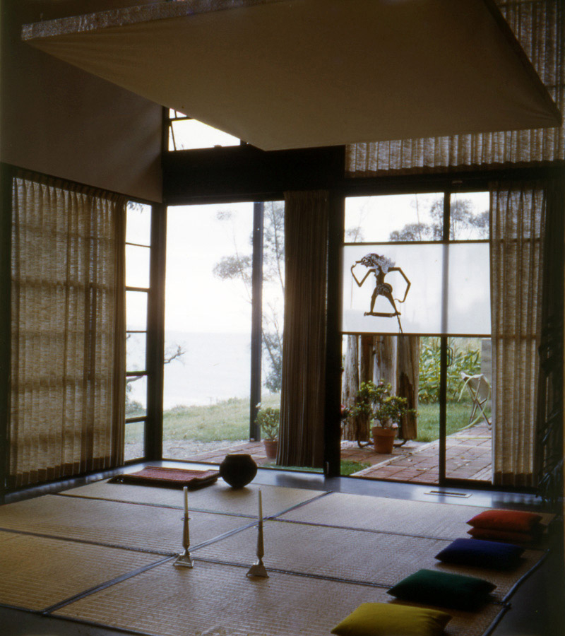 """Another shot from 1950 shows more goza mats and pillows for seating guests. The ocean can be seen beyond the corner window; it is now more obscured by trees. Photo courtesy <a href=""""http://eamesfoundation.org/"""">the Eames Foundation</a>."""