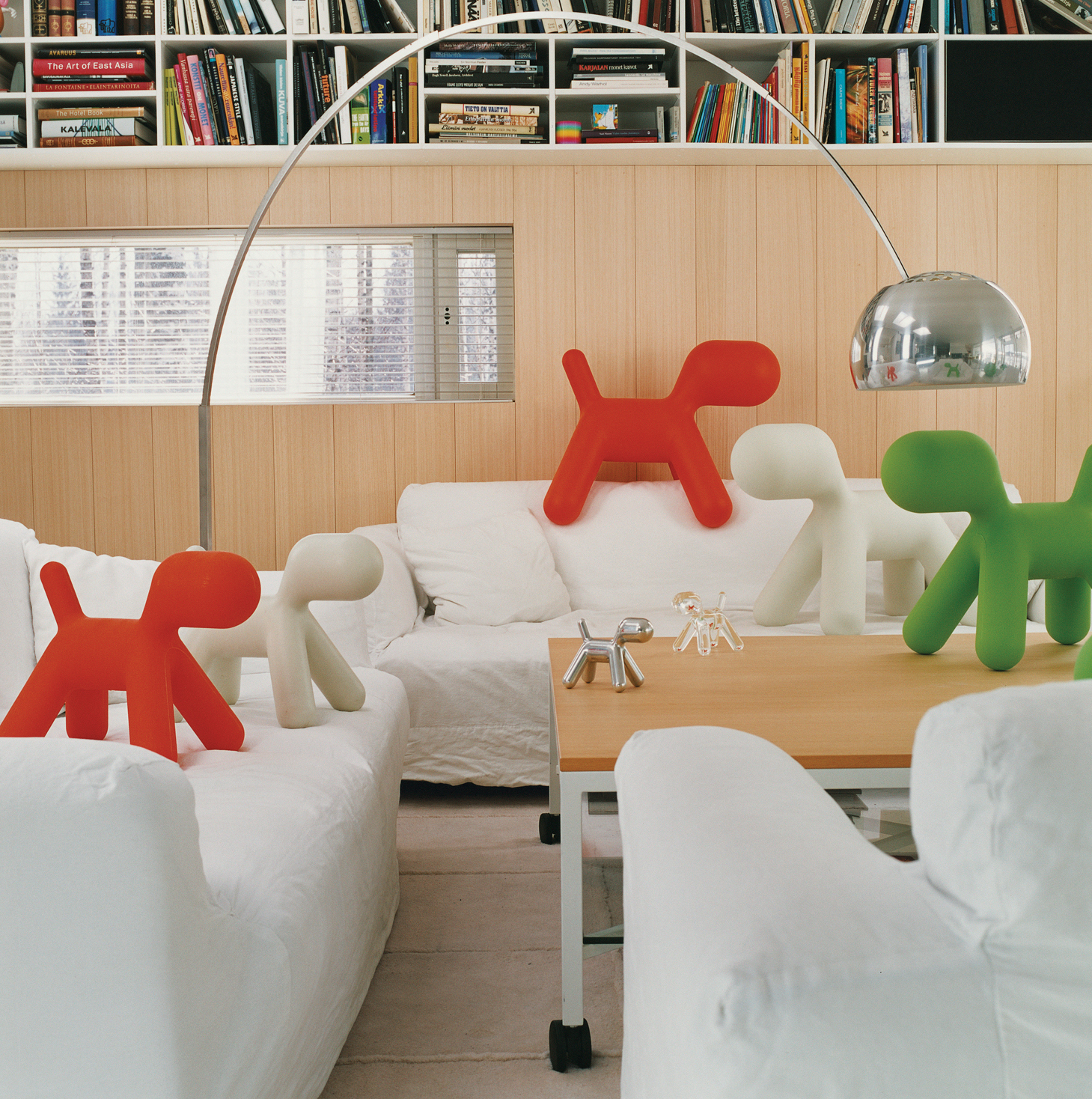 A proliferation of Puppies, Aarnio's 2005 design for Italian manufacturer Magis, gather in the living room of his Veikkola, Finland, home. Aarnio's playful spirit, evident in the iconic Ball Chair, is alive and well in his new work.