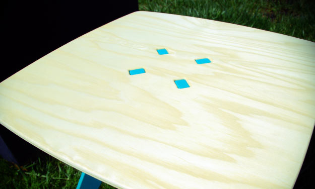 The tops of Modern Farm Furniture's tables and stools come in two options: ash or walnut. Shown here is the ash version.