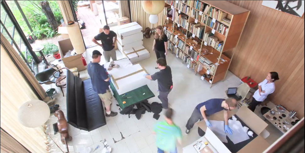 A still from the time lapse video of the Eames living room being packed up and moved.