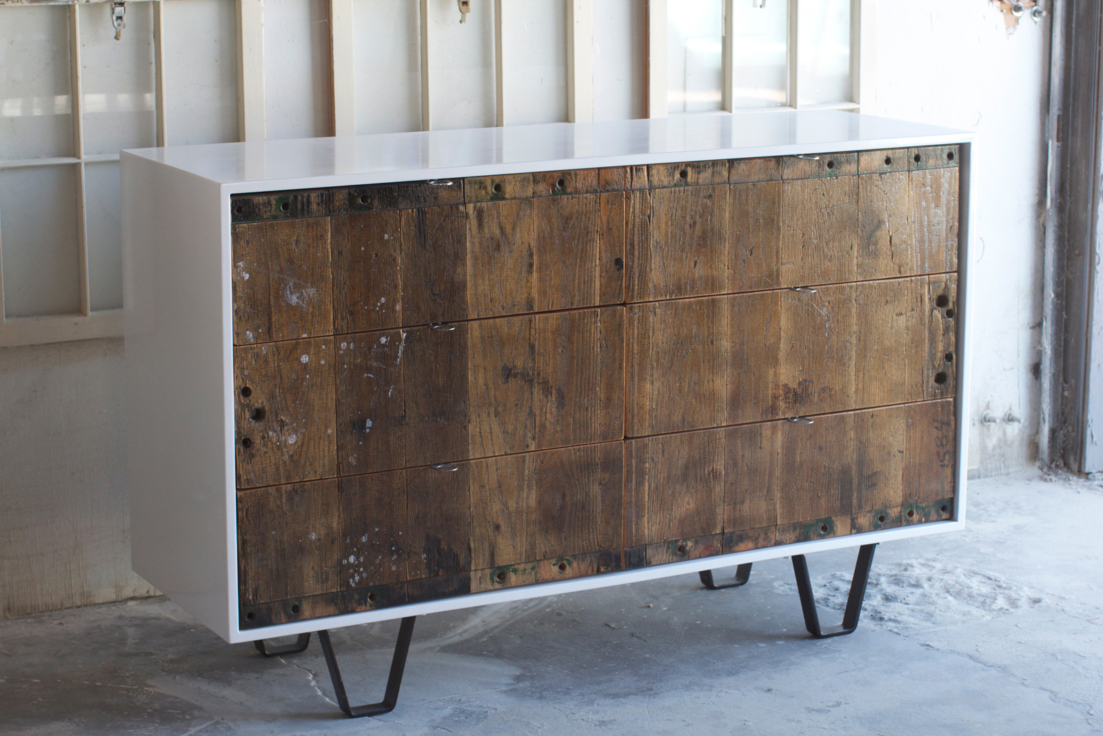 """This console illustrates the contrast of old an new materials found in Fin Art's work. One of their influences is Brooklyn-based furniture maker <a href=""""http://www.palosamko.com/"""">Palo Samko</a>, who has a similar aesthetic."""