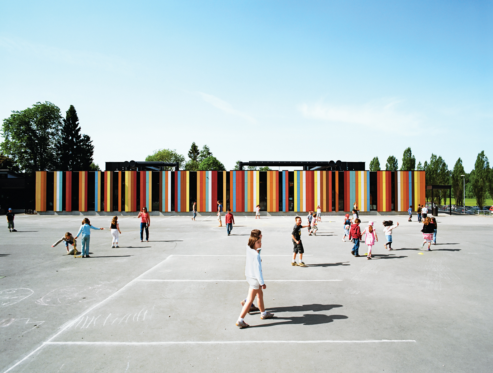 At nearly 80,000 square feet, the Oslo International School is one of Jarmund/Vigsnæs's larger projects. Situated just outside Oslo, the school was recently renovated, with some 40,000 square feet of new construction. The colored panels suggest a sunny op