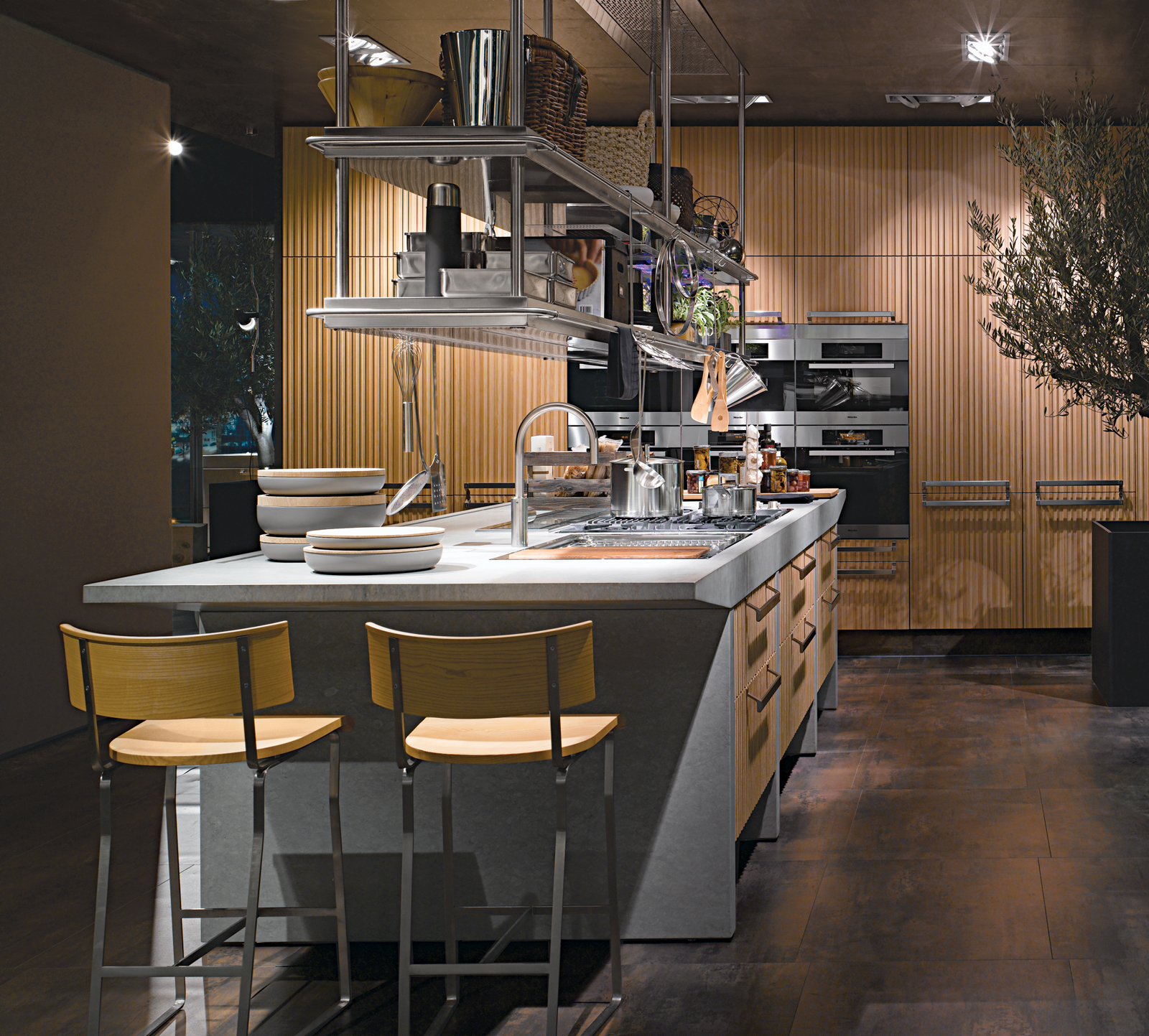 Arclinea's Lignum and Lapis kitchen system features green materials, professional-grade appliances, and advanced technology like a miniature greenhouse for growing herbs indoors and a retractable glass hood over the cooktop.