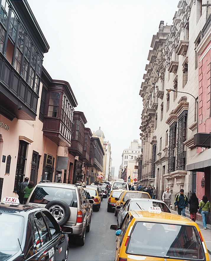 The narrow streets of downtown Lima show the modern alongside the colonial.