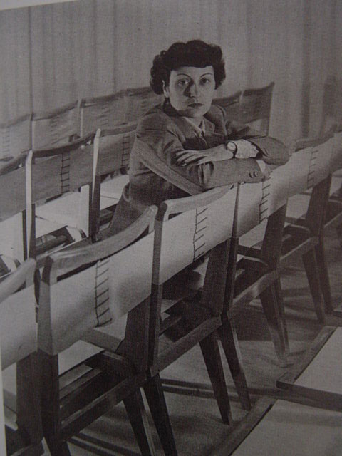 """The architect with her side chair designs, year unknown. Photo courtesy <a href=""""http://espasso.com/"""">Espasso</a>."""