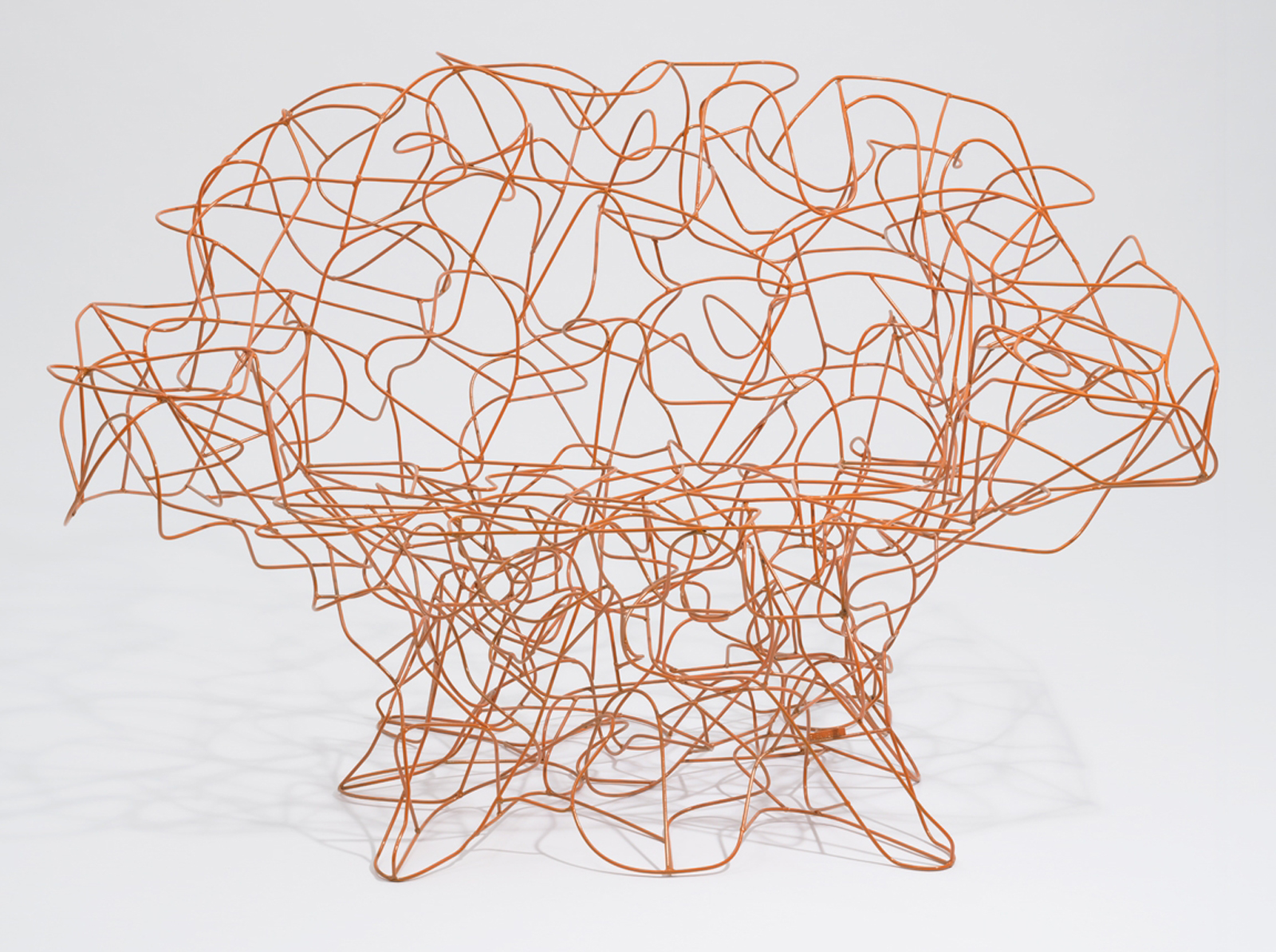 Certainly the most striking of the lot, for its size, color, and form, the Corallo Chair is classic Campana brothers. The bent steel wire is meant to recall the random dynamism of coral branches, and when coated with bright epoxy paint, it also references