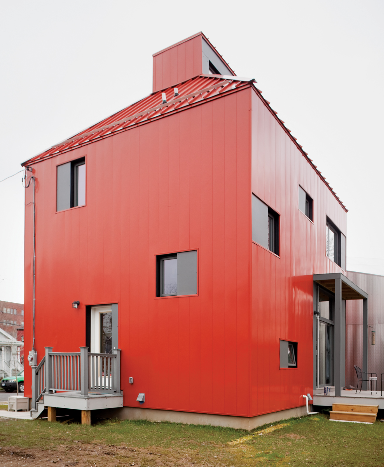 eco house with painted red steel Pac-Clad panels