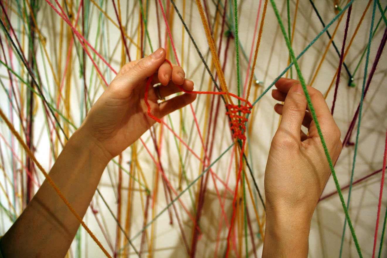 """Unlike modern-day looms that use large wooden structures, Aguiñiga fell in love with the Mayan tradition of back-strap weaving whereby one end is tied to a post and the other around your waist, """"It was really freeing to be able to think about yourself as"""