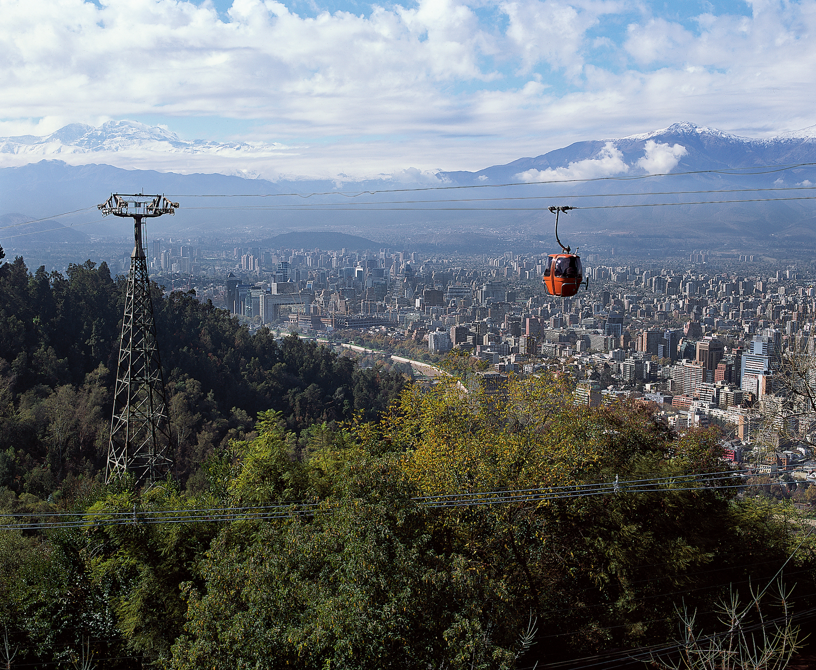 The city's second highest point, Cerro San Cristobal, with its Swiss-style gondolas,  rises some 1,000 feet above the rest of the city and is where Santiaguinos escape the urban bustle to picnic, swim, hike, and wander through gardens. Metropolitan Zoo  i