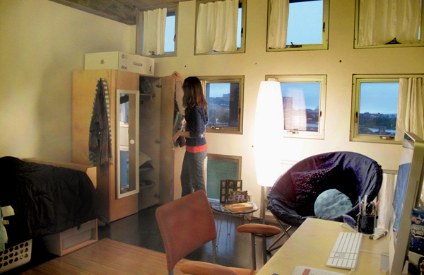 """One of the more spacious singles, Amanda's room has a 3 x 4 array of windows that look out into Boston. """"Thank goodness I don't have a curvy wall anymore,"""" says Amanda."""