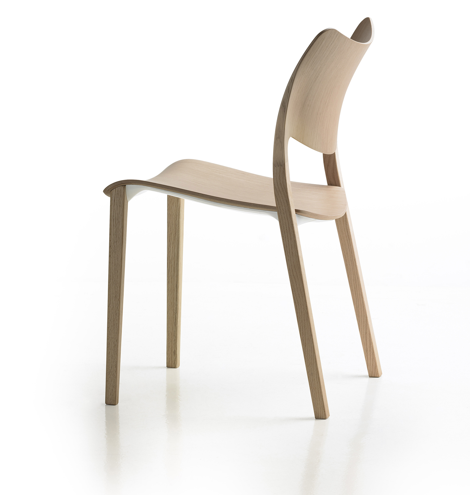 "LACLASICA, Jesus Gasca's latest design. ""It looks like a simple chair,"" says Jon, ""but it's so sophisticated. There are curves created with 3D plywood, and under the seat there's a glowing surface that keeps it all together. When you look at the chair you"