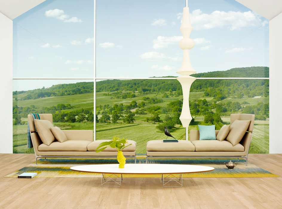 The ideal setup for a long wall of windows: a chaise shape with headrest.