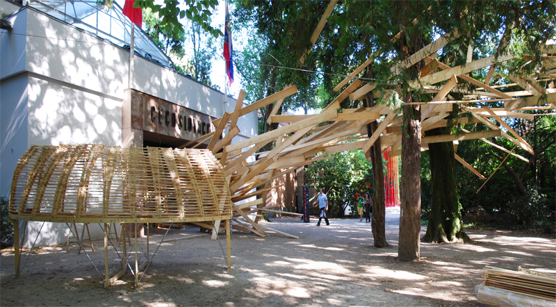 Walking from the direction of the French and Japanese pavilions, visitors were greeted by an explosion of wooden 1x4s lining the trees of the entry pathway. (Formerly the pavilion of Czechoslovakia, the building was designed by Otakar Novotn back in 1926.