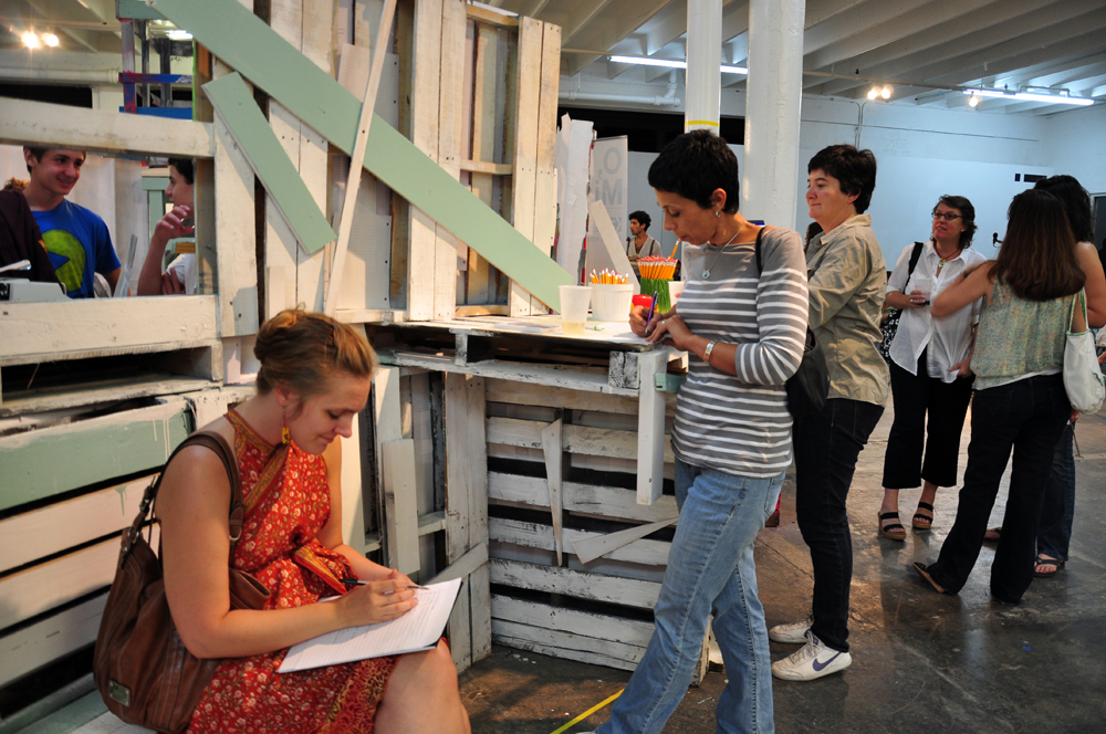 Visitors explore the writing environments at ArtSeen Gallery. Photo by Robby Campbell