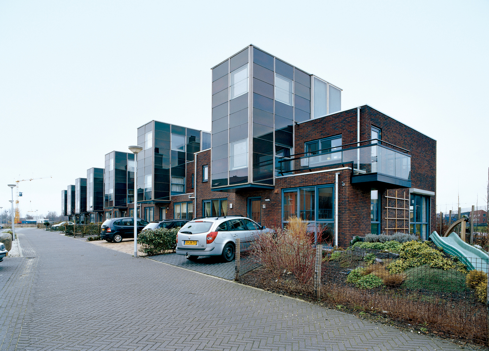"Arranged and slotted together like a tidy row of Legos, the IJsselstein housing project reflects typical Dutch efficiency, ""not just in terms of materials used,"" notes architect Gregory Kiss, ""but in terms of space as well."""