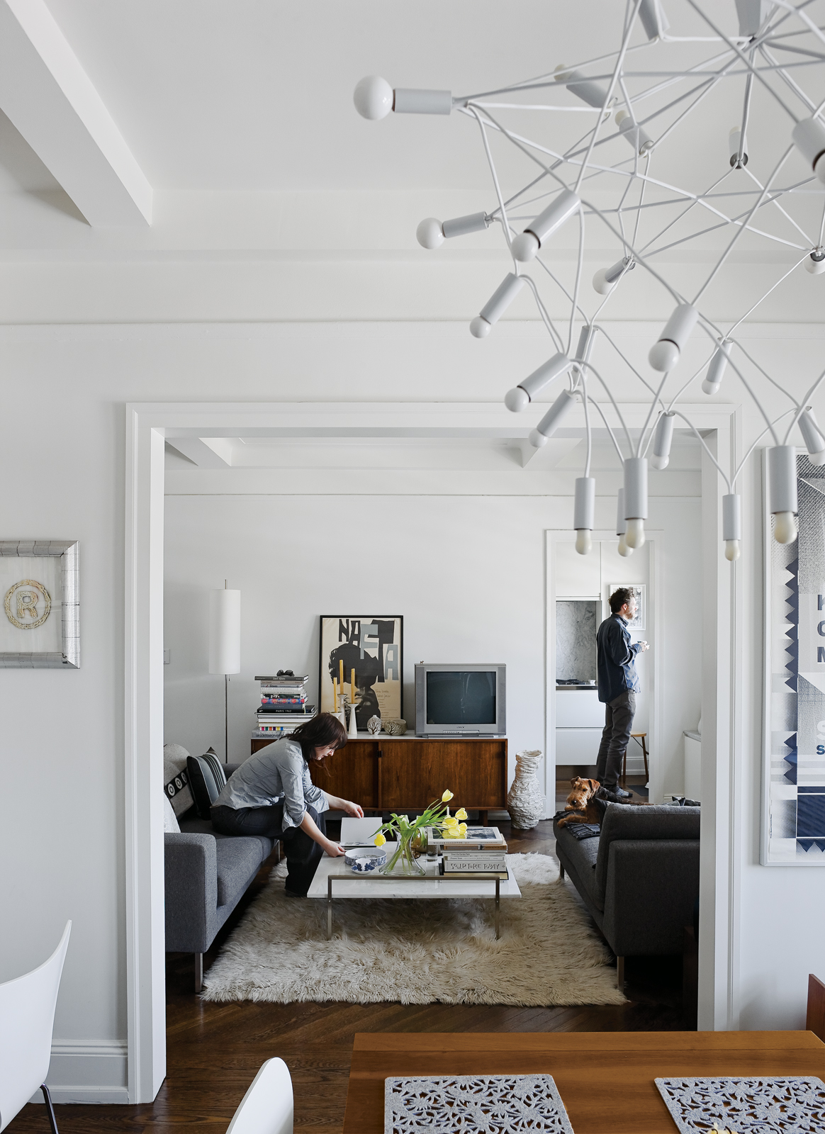 Up on the ninth floor, their sober Neo sofa and chaise from DWR and classic Florence Knoll credenza are contrasted by more exotic accessories like Patrick Townsend's Orbit chandelier and an offbeat white vase from Creative Growth, an Oakland, California,