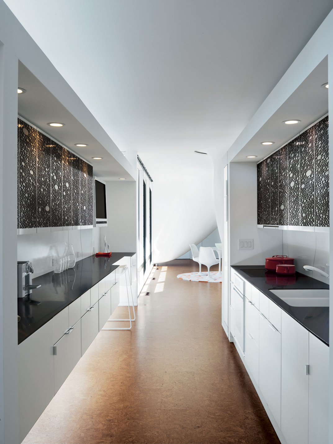 The kitchen is a long sleek space.